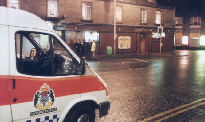 Police outside the Bowbridge Bar in Hilltown in October 1998 after Owen Alexander Kerr murdered Andrew Tosh.