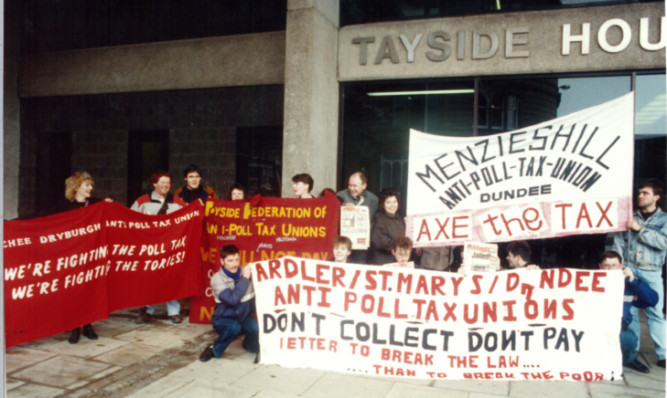 Campaigners protest against the poll tax in Dundee in 1990.
