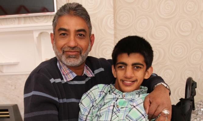 Tubarik Hussain with his guardian, Sandy Sarwar.