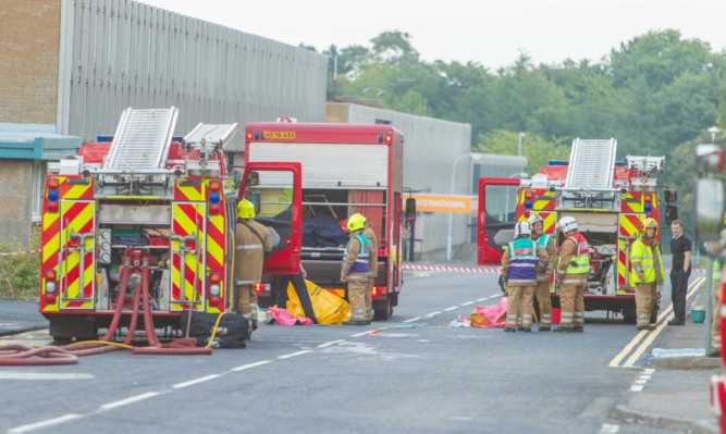 Firefighters get the blaze at the K Hartwall building under control.