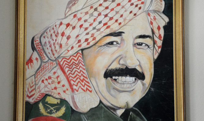 An unfinished portrait of Saddam Hussein which was 'liberated' from Kuwait.