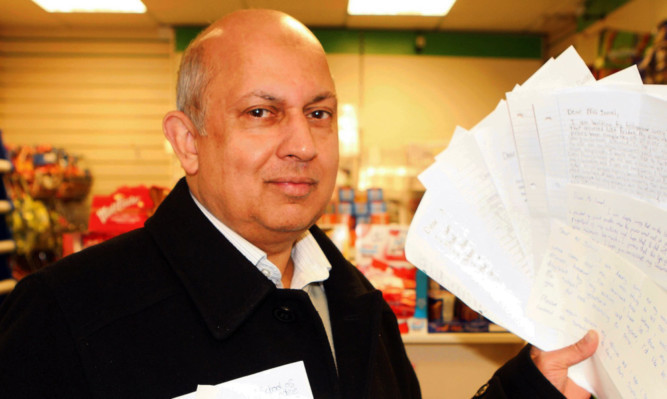 Mr Jamal with some of the letters of apology from pupils.