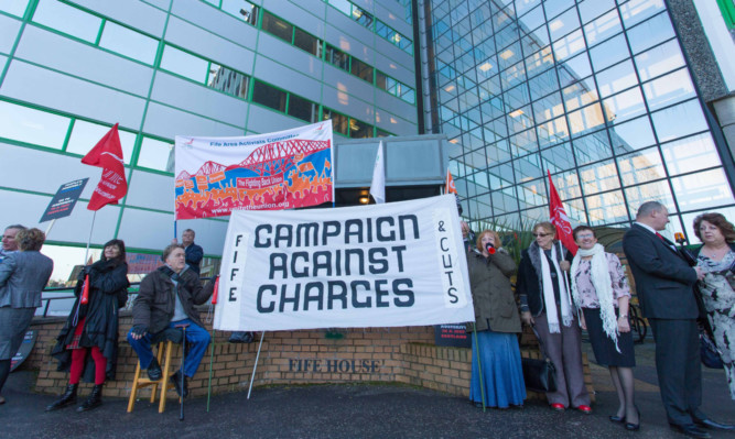 Campaigners outside Fife House in Glenrothes before the budget meeting last month that is still causing political arguments.