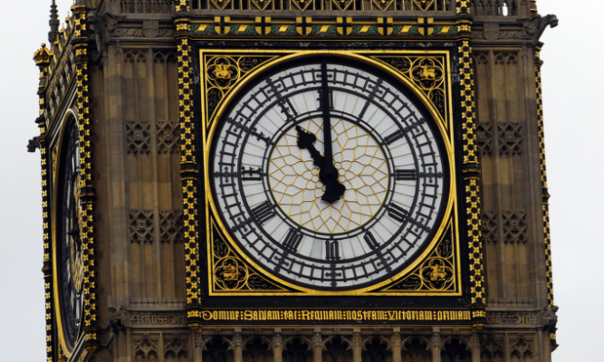 STANDALONE  Photo:  Big Ben strikes 11.00 am. This year's Armistice Day is 11/11/11.  PPESS ASSOCIATION Photo: Rebecca Naden/PA Wire