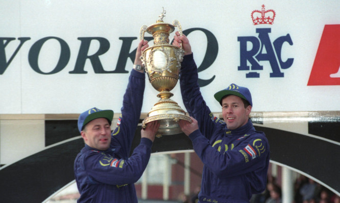 Colin McRae, right, celebrates his world championship win in 1995 with co-driver Derek Ringer.