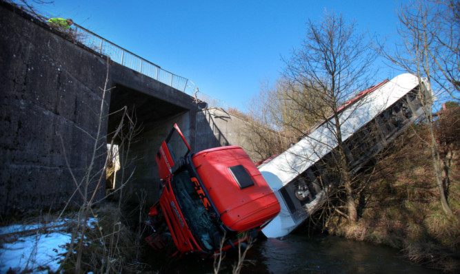 It is believed the vehicle may have lost control on black ice crashing down embankment.