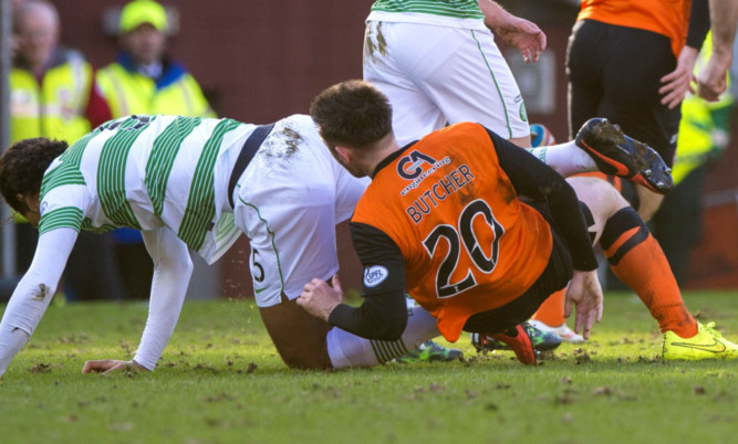 Virgil Van Dijk (left) and Calum Butcher clash.