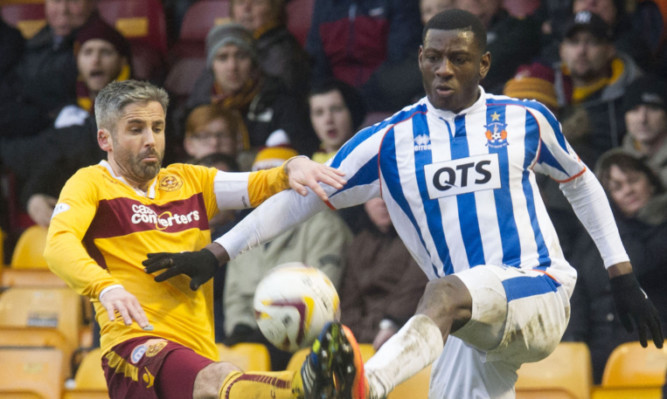 Motherwell's Keith Lasley battles for the ball with Tope Obadeyi.