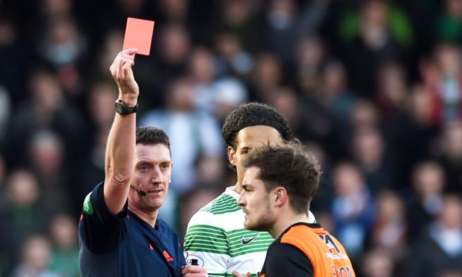 Referee Craig Thomson sends off Dundee Utd's Paul Paton.