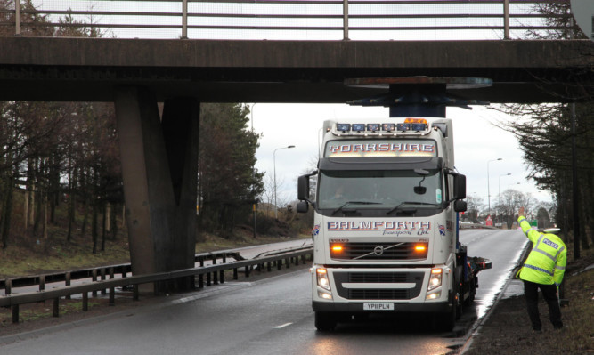 The lorry became trapped under a flyover on the west-bound carriageway on Monday afternoon.