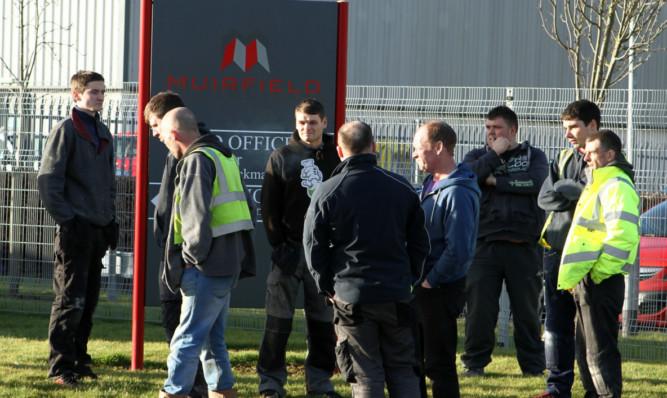Workers outside the Muirfield premises in Camperdown Industrial Park.