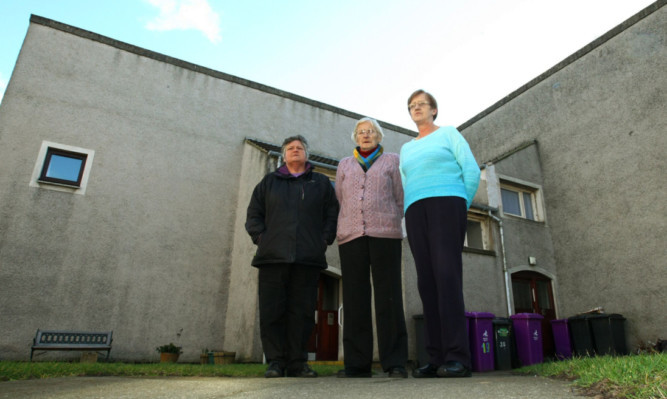 At Priory Court in Forfar are, from left, Wilma Whyte, Margaret Massie and Martha Jamieson. Residents there and in other streets are unhappy about ongoing phone problems.