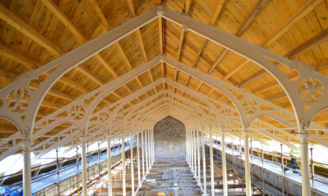The interior of the High Mill, showing its gothic cast iron roof trusses after its restoration.