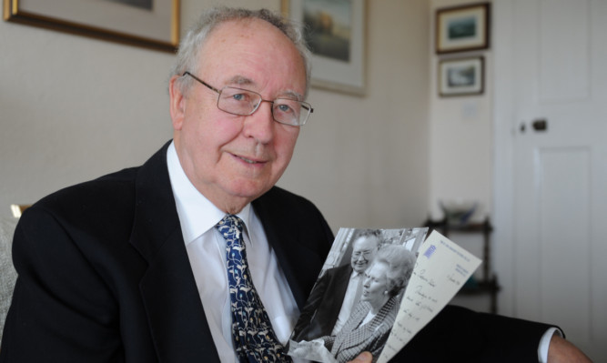 Sir William with some memorabilia from his time as Margaret Thatcher's chief scientific officer.