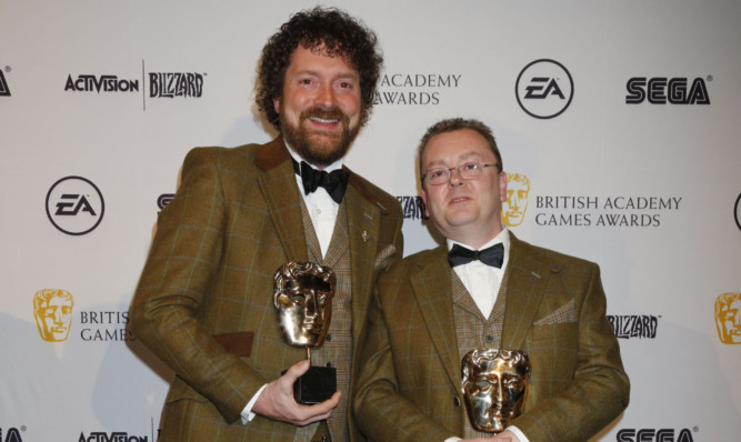 Chris van der Kuyl and Paddy Burns of 4J Studios with their awards.