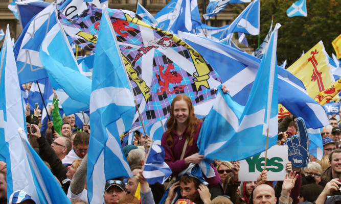 Scottish Independence supporters at the Hope over Fear Rally in George Square in Glasgow, which is aimed at keeping the momentum of YES supporters going. PRESS ASSOCIATION Photo. Picture date: Sunday October 12, 2014. See PA story SCOTLAND Rally. Photo credit should read: Andrew Milligan/PA Wire