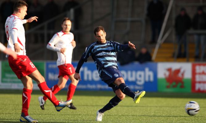 Forfars Gavin Swankie goes for goal.