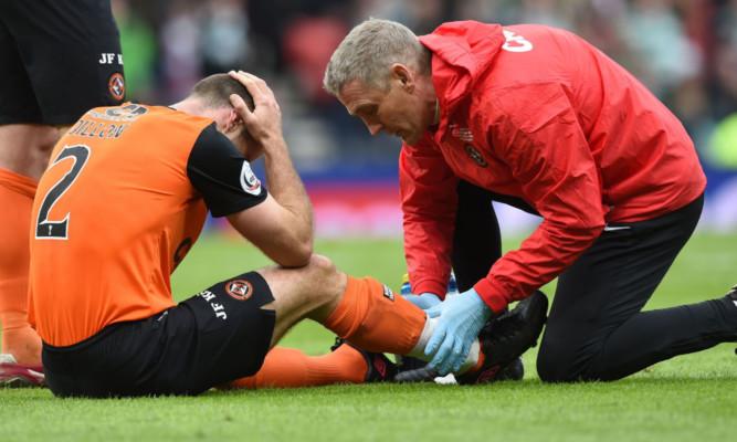 Sean Dillon receiving treatment after clash with Virgil van Dijk.