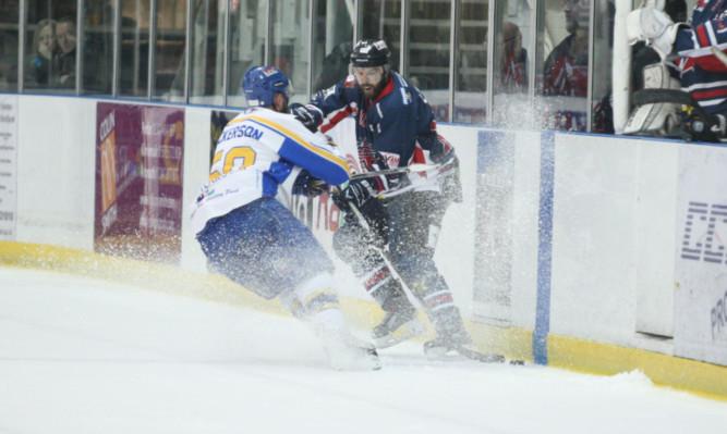 Stars Shane Lust takes on Flyers Matt Nickerson.