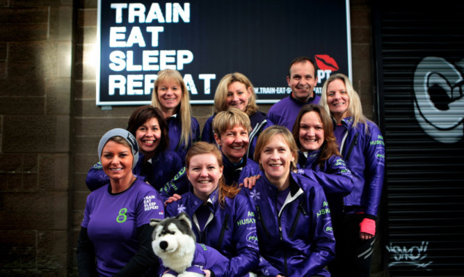 The team with trainer Shelley Booth, front left.