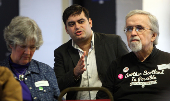 Jonathan Shafi, centre, national spokesman for the Radical Independance Campaign speaking to members of the audience.