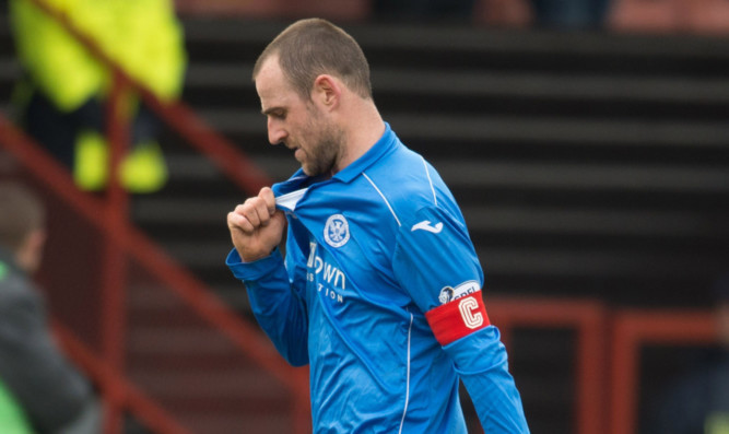 Dejection for St Johnstone captain Dave Mackay at Firhill.