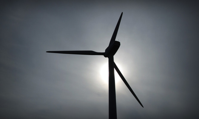 Kris Miller, Courier, 04/03/13. Picture today at Methil shows the wind turbine at Methil docks. Plans to build a turbine, five times the size of this one have been submitted. **Sky left at top of pic as requested.