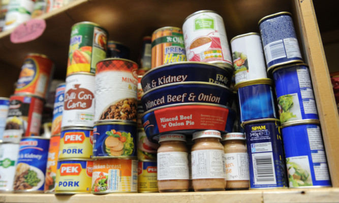07.10.14 - FOR FILE - pictured in the foodbank in the Old and Abbey Church, West Abbey Street, Arbroath are some of the foodstuffs whcih will be distributed on the shelves