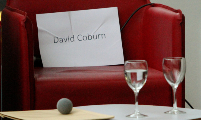 Monday's debate went ahead with Mr Coburn 'empty chaired'.