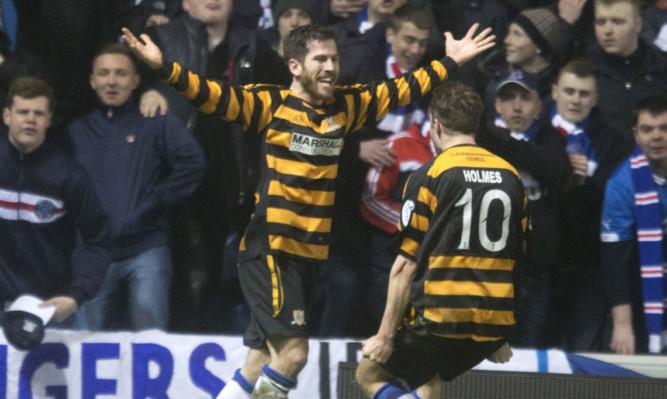 Liam Buchanan celebrates his late leveller.