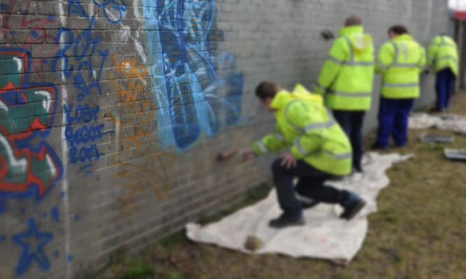 Offenders carrying out community payback work in Dundee.