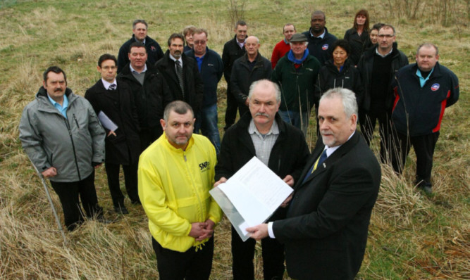 Craig Walker, SNP candidate in the Glenrothes West and Kinglassie by-election, Stuart Dunn and Bill Brown, holding the petition, with representatives from the businesses in the area.