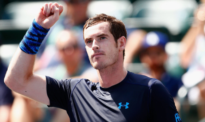 Andy Murray celebrates defeating Adrian Mannarino.