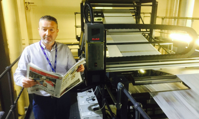 Guy Forester, head of operations (newspapers), prepares for the Courier Code competition on Saturday. Every reader has the chance to win £500.