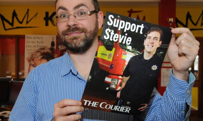 Kingdom FM presenter Barry Sneddon holds up The Courier poster.