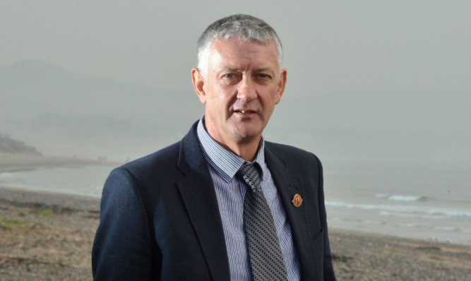 Councillor Tom Adams.