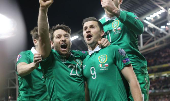 Shane Long (right) celebrates his goal.