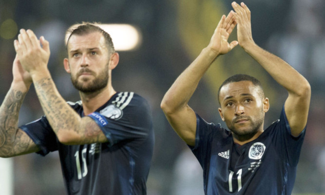 Steven Fletcher and Ikechi Anya.