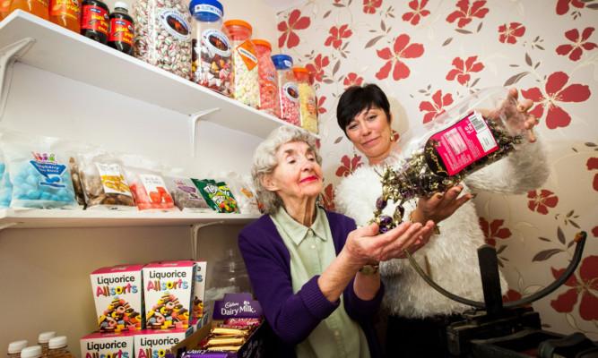 Ann Cosgrove and Debbie Douglas prepare the shop for more customers.