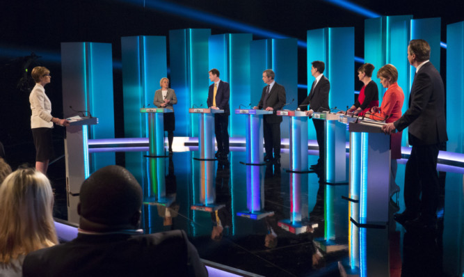SALFORD, ENGLAND - APRIL 2: (EDITORIAL USE ONLY. NO MERCHANDISING. NO ARCHIVE AFTER MAY 02, 2015)  In this handout provided by ITV, (L-R): Green Party leader Natalie Bennett, Liberal Democrat leader Nick Clegg, UKIP leader Nigel Farage, Labour leader Ed Miliband, Plaid Cymru leader Leanne Wood, Scottish National Party leader Nicola Sturgeon and British Prime Minister and Conservative leader David Cameron take part in the ITV Leaders' Debate 2015 at MediaCityUK studios on April 2, 2015 in Salford, England. Tonight sees a televised leaders election debate between the seven political party leaders. The debate will be the only time that David Cameron and Ed Miliband will face each other before polling day on May 7th.  (Photo by Ken McKay/ITV via Getty Images)