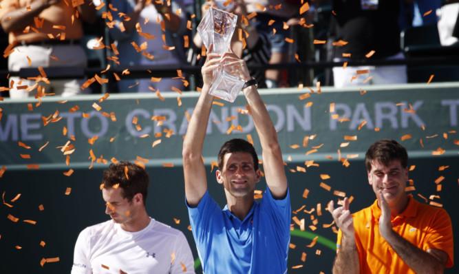 The celebrations begin as Novak Djokovic lifts the Miami Open trophy.