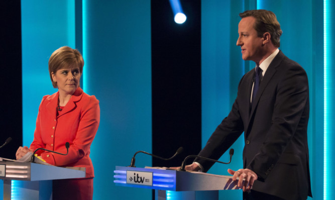 Nicola Sturgeon and David Cameron during last week's TV debate. She denies saying she would prefer him as Prime Minister rather than Labour leader Ed Miliband.