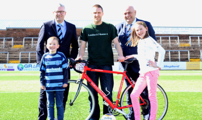 Stephen Cormie  with his children Callum, 7, and Jessica, 10, Forfar chairman Alastair Donald, back left, and boss Dick Campbell  will be saddle sore after his challenge.