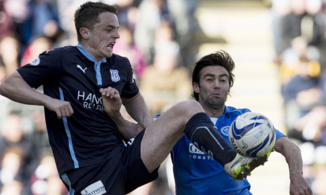 Dundee's Stephen McGinn challenges Simon Lappin.