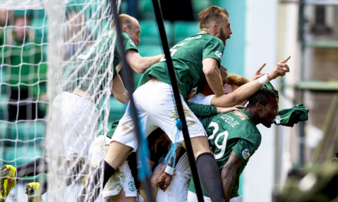 Hibs players mob Farid El Alagui after he scores his side's second goal of the game.
