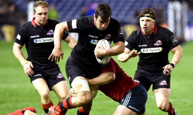 Stuart McInally, centre, is challenged by Munsters Felix Jones, left, and Donnacha Ryan.
