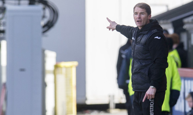 Alan Archibald instructs his team from the sidelines.