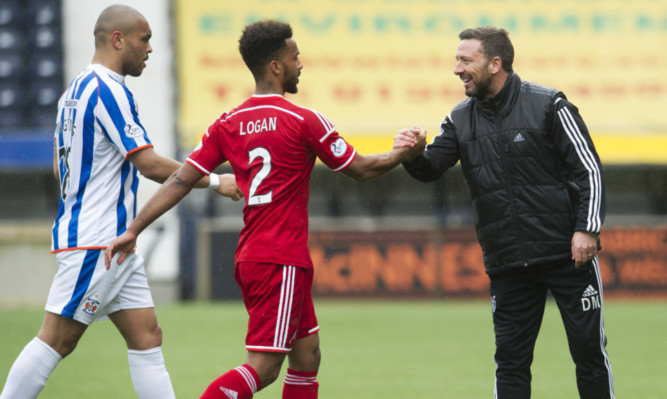 Aberdeen manager Derek McInnes  shakes hands with Shay Logan at full-time.