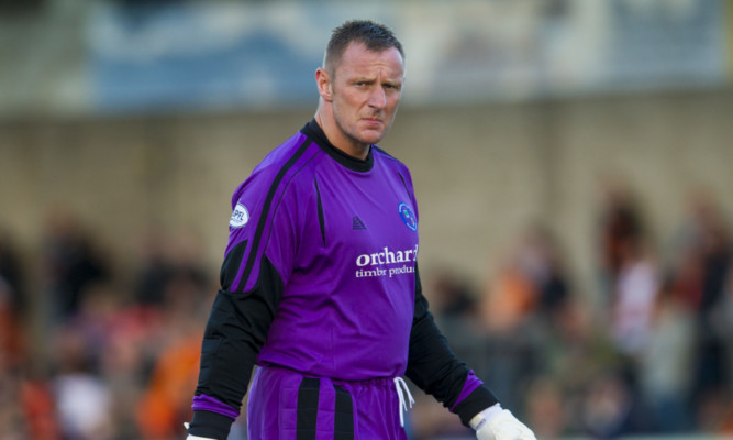 Rab Douglas had to defend himself after a pitch invasion at Station Park at the weekend.