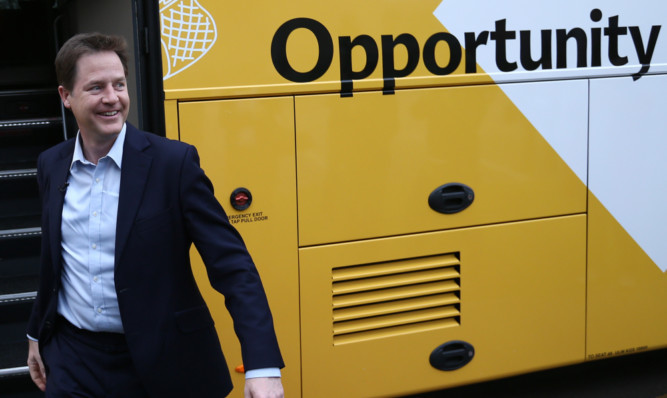 Liberal Democrat leader Nick Clegg arrives to meet with apprentices and local employers during a visit to Mid- Kent College in Maidstone.